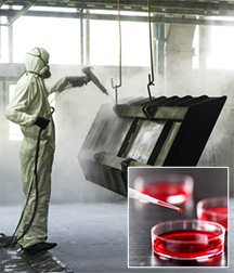 Worker using a sprayer; inset image of cell culture plates