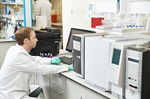 Laboratory researcher working at computer