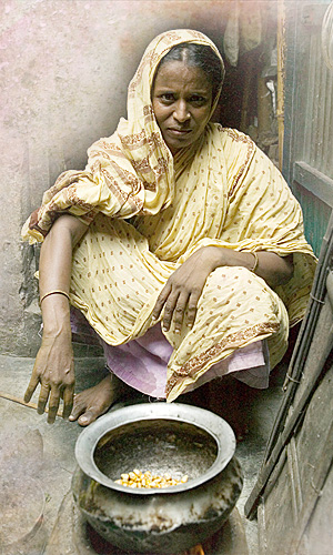 Woman outside with stove