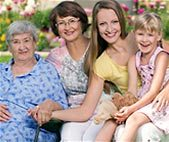 photo of four females of different ages and generations