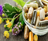 Botanical dietary supplements pills in a glass bowl