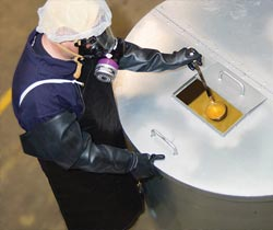 Worker in safety gear handling diacetyl