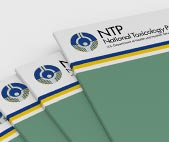 Stack of printed NTP research reports